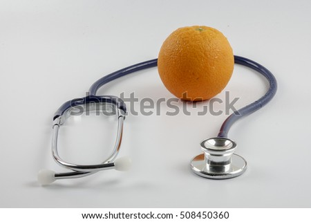Stethoscope with orange  concept for diet, healthcare, nutrition or medical insurance