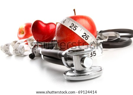 Stethoscope with red apples on a white background