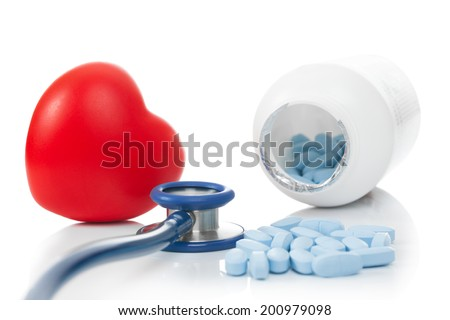 Stethoscope with red heart and pills - studio shoot on white - stock photo