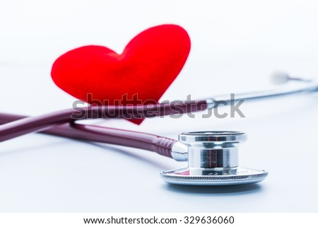 Stethoscope with red heart on white background.  - stock photo