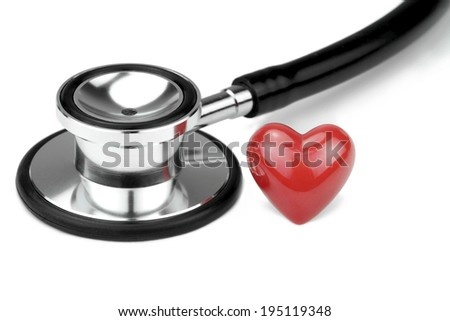 Stethoscope with red heart shape on white background. Macro image. - stock photo