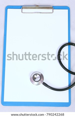 Stetoschope and sheet of paper. Medical equipment. For medical healthcare