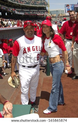Steve Soliz, Eva Longoria make an appearance to throw out the first pitch at the Los Angeles Angels baseball game against the New York Yankees, Angel Stadium, Anaheim, CA, Sunday, July 24, 2005