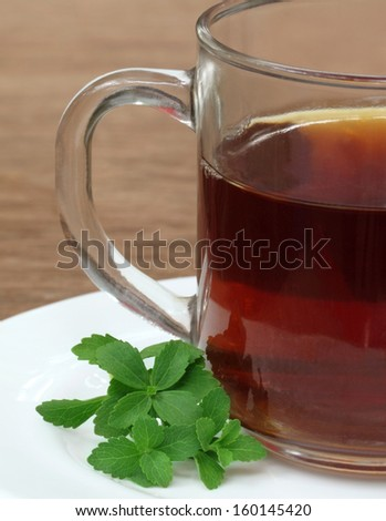 Stevia with cup of tea - stock photo