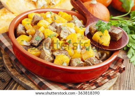 Stew beef with pumpkin in a ceramic pot