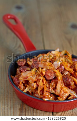 stew cabbage with a sausage - stock photo