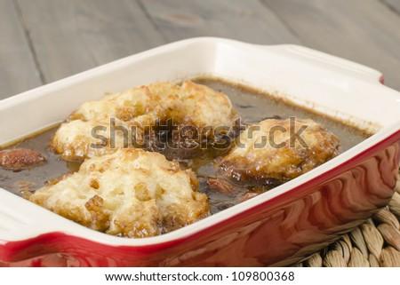 Stew & Dumplings - Casserole of stewed beef, vegetables and dumplings. - stock photo