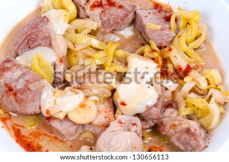 Stew with peppers, onions and cheese.