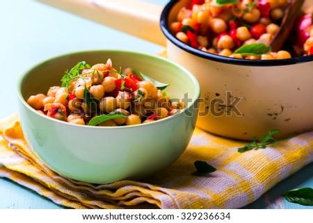 stewed chick-pea with vegetables. vegetarian dish. style vintage. Selective focus - stock photo