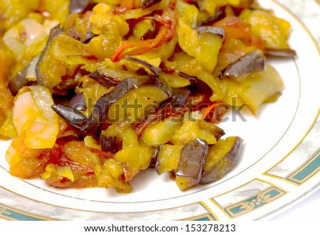 stewed eggplant with tomato on a plate
