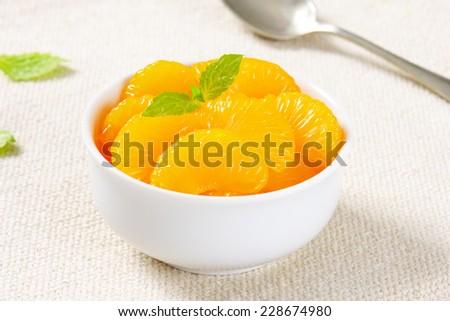 Stewed mandarine in a bowl - stock photo