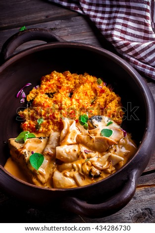 Stewed mussels in big ceramic pot. Style rustic. Selective focus. - stock photo
