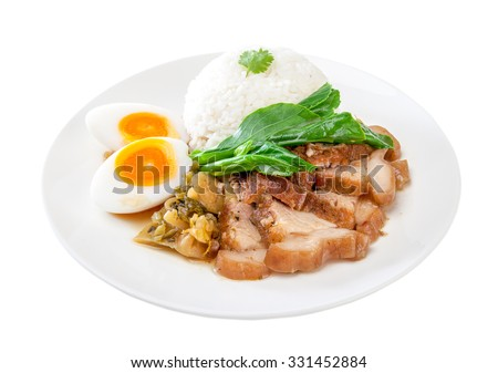 Stewed pork leg with rice on white background. Thai food  Stewed pork leg with rice on white background. Thai food