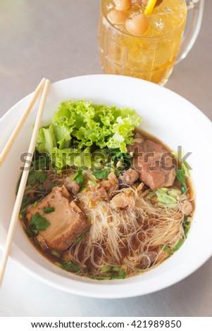 stewed pork longan noodle, with longan juice. - stock photo