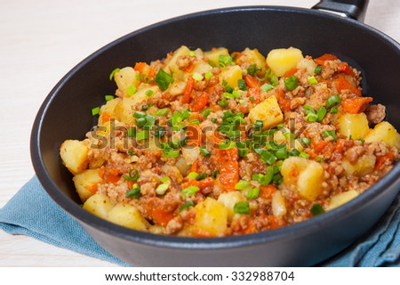 stewed potato with minced meat in a frying pan