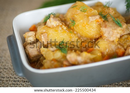 stewed potatoes with meat and vegetables in the form  - stock photo