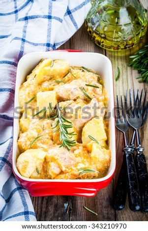 stewed rabbit with potatoes in cream sauce with rosemary - stock photo
