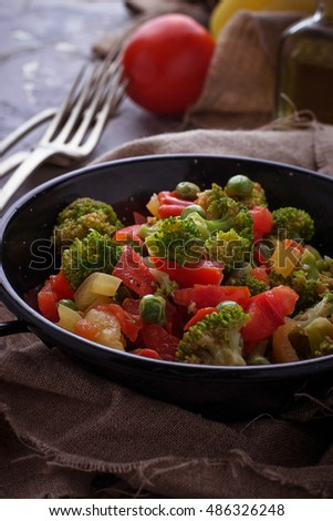 Stewed vegetable tomato, broccoli, peas, pepper. Selective focus