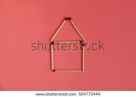 Stick matches house on the pink background