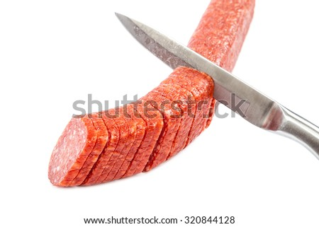 Stick sausage and a knife isolated on a white background. - stock photo