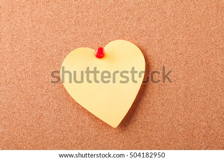 sticker-heart on corkboard