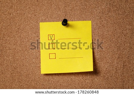 sticker note on cork board with checkboxes, empty - stock photo