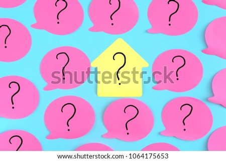 Stickers on a blue background pink stickers with question marks in the center is