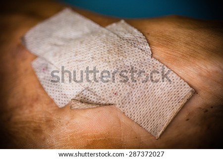 Sticking plaster on a skin