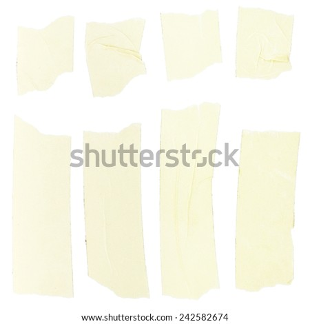 Sticking tape pieces isolated on white - stock photo