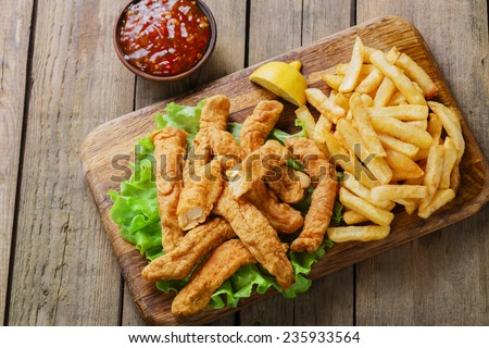 sticks breaded chicken with potatoes - stock photo
