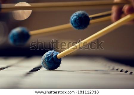 Sticks hitting a xylophone closeup - stock photo