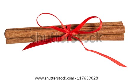 sticks of cinnamon with ribbon bow isolated on white