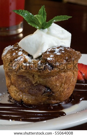 Sticky bread pudding cake with whipped cream and fruit - stock photo