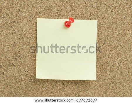 Sticky note on cork board background