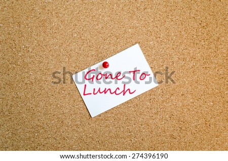 Sticky Note On Cork Board Background Gone To Lunch Concept - stock photo