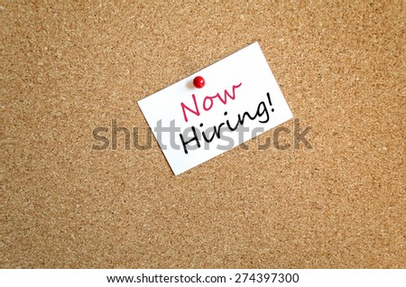 Sticky Note On Cork Board Background Now Hiring Concept - stock photo