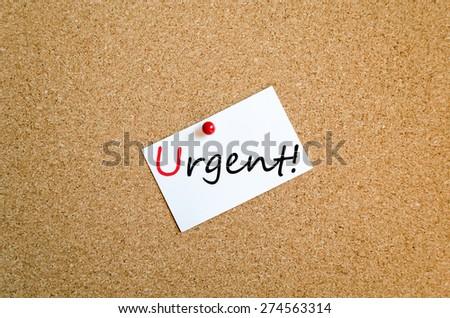 Sticky Note On Cork Board Background Urgent Concept - stock photo