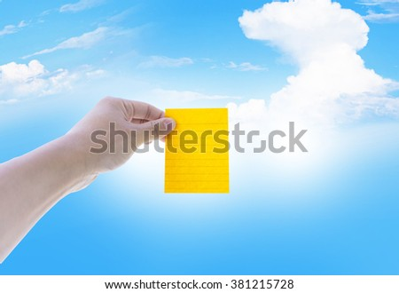 Sticky note on man hand with sky and cloud background - stock photo
