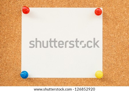 Sticky note pushed on the board - stock photo