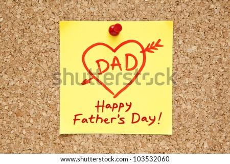 Sticky note with Happy Fathers Day on a cork bulletin board. - stock photo