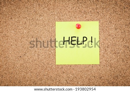 sticky note with word help on corkboard, business concept