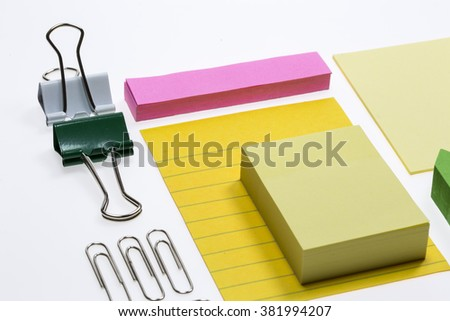 Sticky notes and binder clips