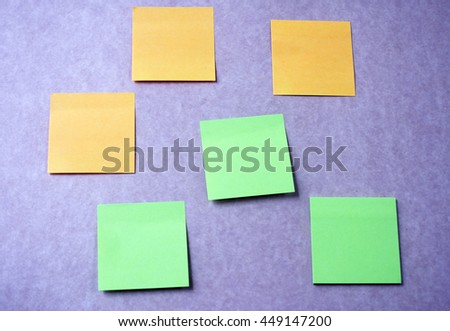 Sticky notes on purple wall