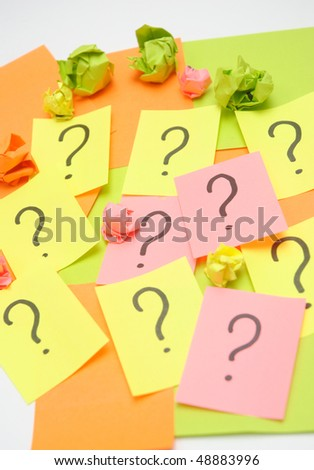 sticky notes with question marks over white - stock photo