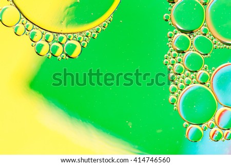 Sticky oily bubbles. Macro photography in the studio, oil and water, lights and reflections. - stock photo