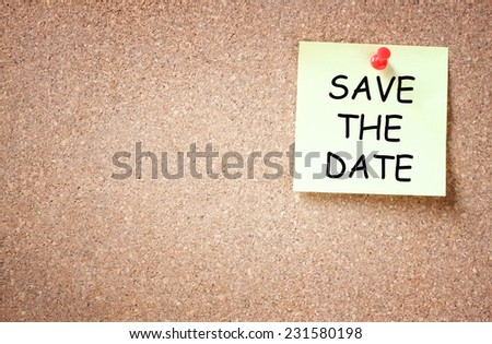 sticky pinned to cork board with the phrase save the date. room for text - stock photo