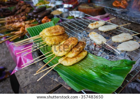 sticky rice grilled at street market in Luang prabang, Laos. - stock photo
