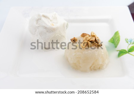 Sticky Rice with coconut milk on top and bean with white ice-cream beside - stock photo