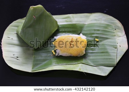 Sticky rice with steamed custard, wrapped in banana leaves,Thai dessert