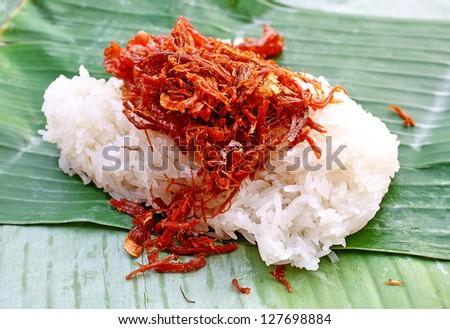 Sticky rice with sweet pork chop on banana leaf plate. Thai local food.Northern thai food - stock photo